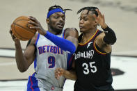 Detroit Pistons' Jerami Grant (9) drives against Cleveland Cavaliers' Isaac Okoro (35) in the second half of an NBA basketball game, Wednesday, Jan. 27, 2021, in Cleveland. (AP Photo/Tony Dejak)
