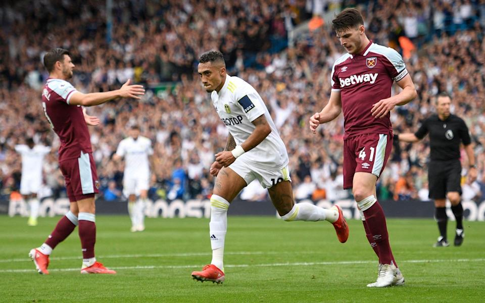 Leeds United's Brazilian midfielder Raphinha Dias Belloli celebrates scoring his team's first goal during the English Premier League football match between Leeds United and West Ham United at Elland Road in Leeds, northern England on September 25, 2021. - GETTY IMAGES
