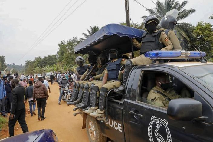 Ugandan riot police are seen on a pickup truck near the house of the presidential candidate and singer Robert Kyagulanyi Ssentamu, known as Bobi Wine, in Magere neighbourhood of Kampala