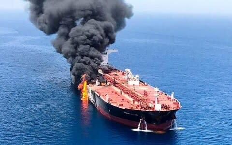 An oil tanker is seen after it was attacked at the Gulf of Oman - Credit: Reuters