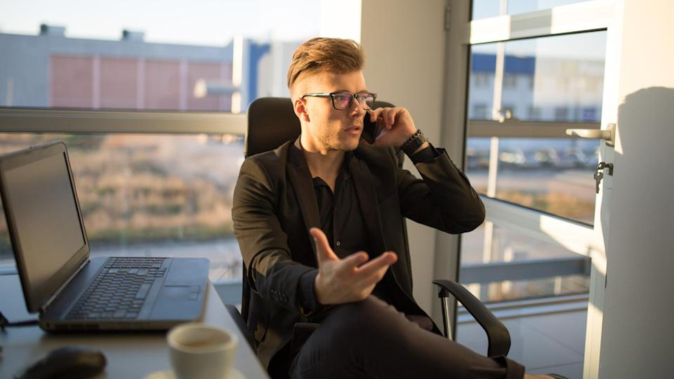 Young businessman on the phone.