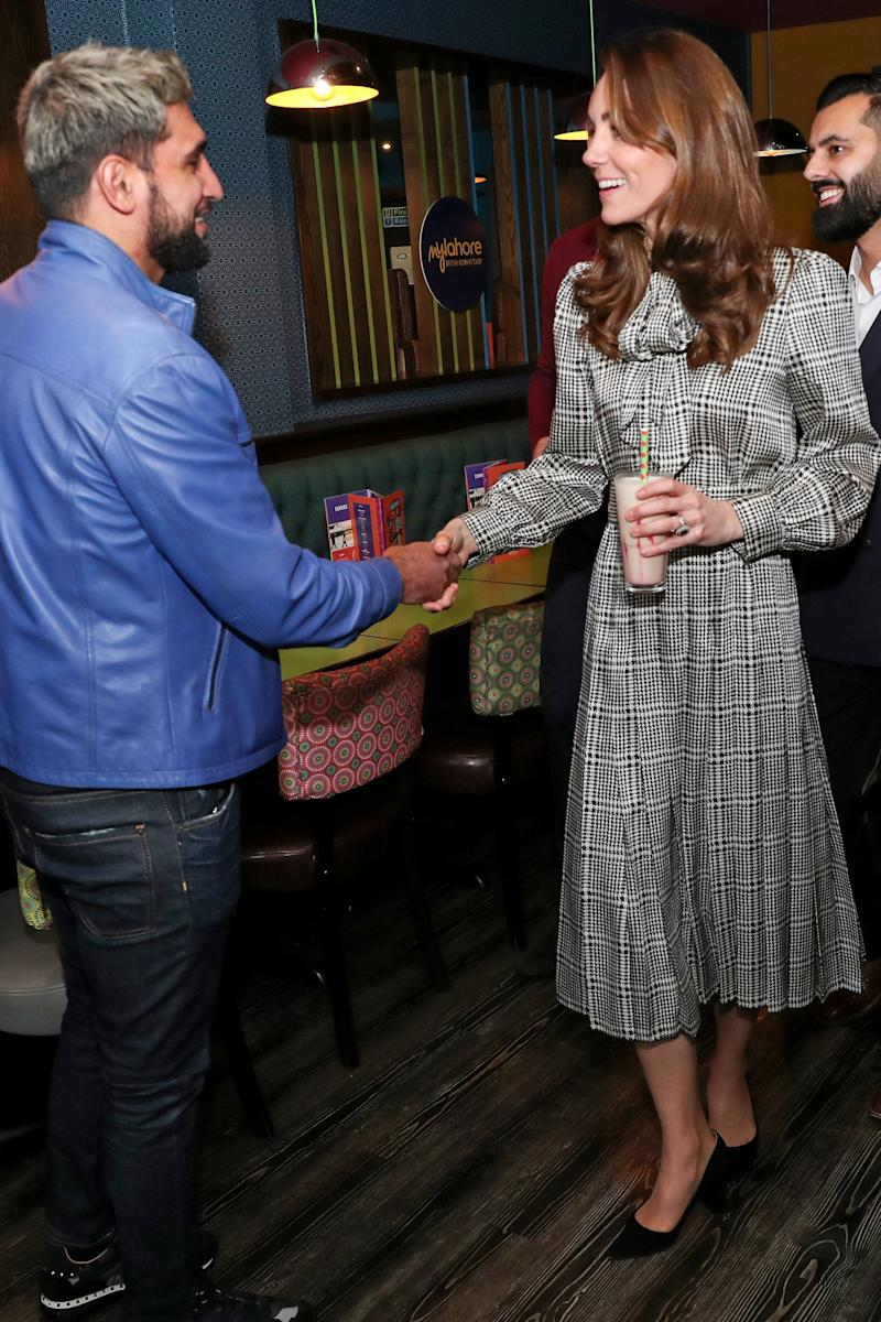 The Duchess of Cambridge meets with Amir Khan during a visit to MyLahore's flagship restaurant.  (Photo: Chris Jackson via Getty Images)