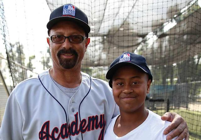 Kenny Landreaux, the Urban Youth Academy's coordinator of baseball instruction, posing with a younger George Eaves.