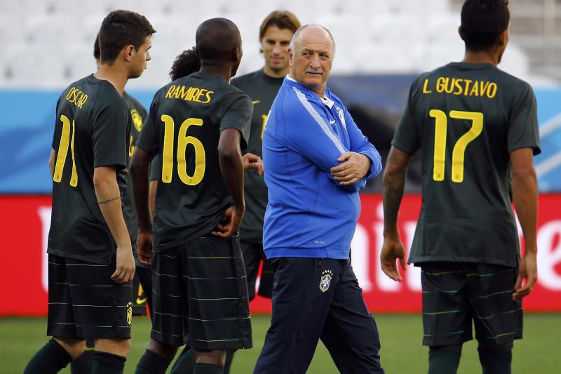 Brazil's national soccer team coach Luiz Felipe Scolari talks to his players during their team's final practice in Sao Paulo