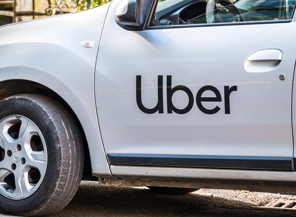 Bucharest/Romania - 10.17.2020: Uber logo inscriptioned on a white painted car. Uber car in traffic.