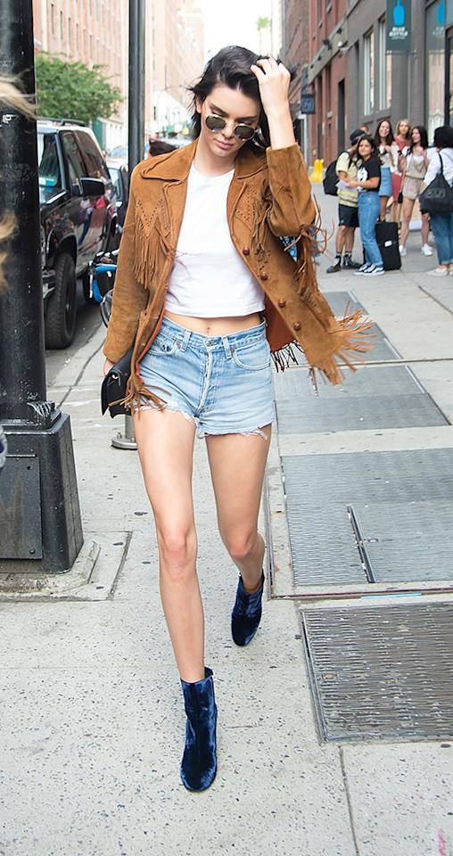 <p>On Sunday, July 10, Kendall Jenner threw on the perfect outfit to go exploring the Whitney Museum of American Art: a pair of light blue cutoffs and a fringed Western jacket. The model kept her makeup light for the steamy day and completed her look with a pair of sunglasses. <i>(Photo: Josiah Kamau/BuzzFoto via Getty Images)</i></p>