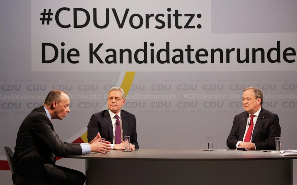 Friedrich Merz (left), Norbert Roettgen and Armin Laschet (right) take part in a discussion at the Christian Democratic Union's headquarters in Berlin - Markus Schreiber /AP