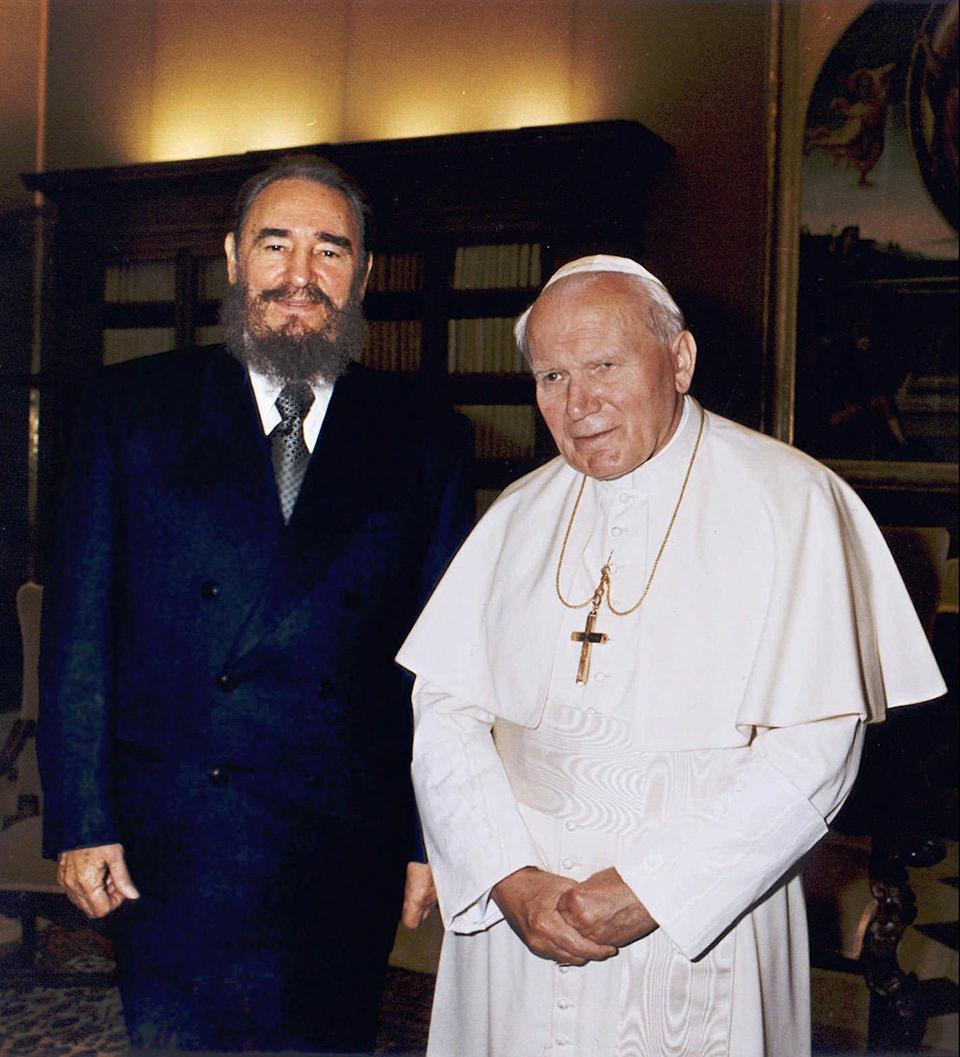 <p>Cuban leader Fidel Castro and Pope John Paul II pose during their historical meeting at the Vatican Tuesday, November 19 1996. Castro invited the Pope to visit Cuba next year. The Pontiff accepted, but no date for the visit has been set. (AP Photo/Arturo Mari) </p>
