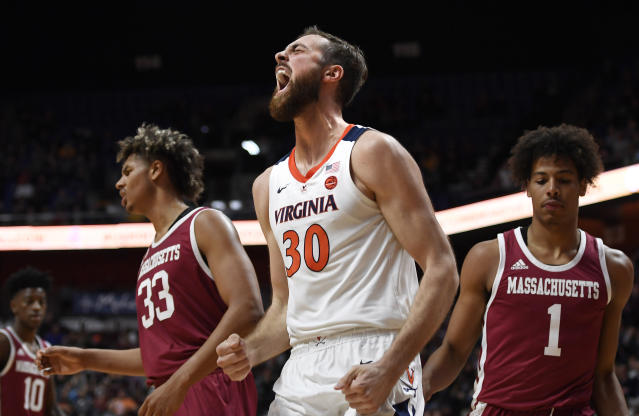 Virginia's Jay Huff reacts during the second half of an NCAA college basketball game against Massachusetts, Saturday, Nov. 23, 2019, in Uncasville, Conn. (AP Photo/Jessica Hill)