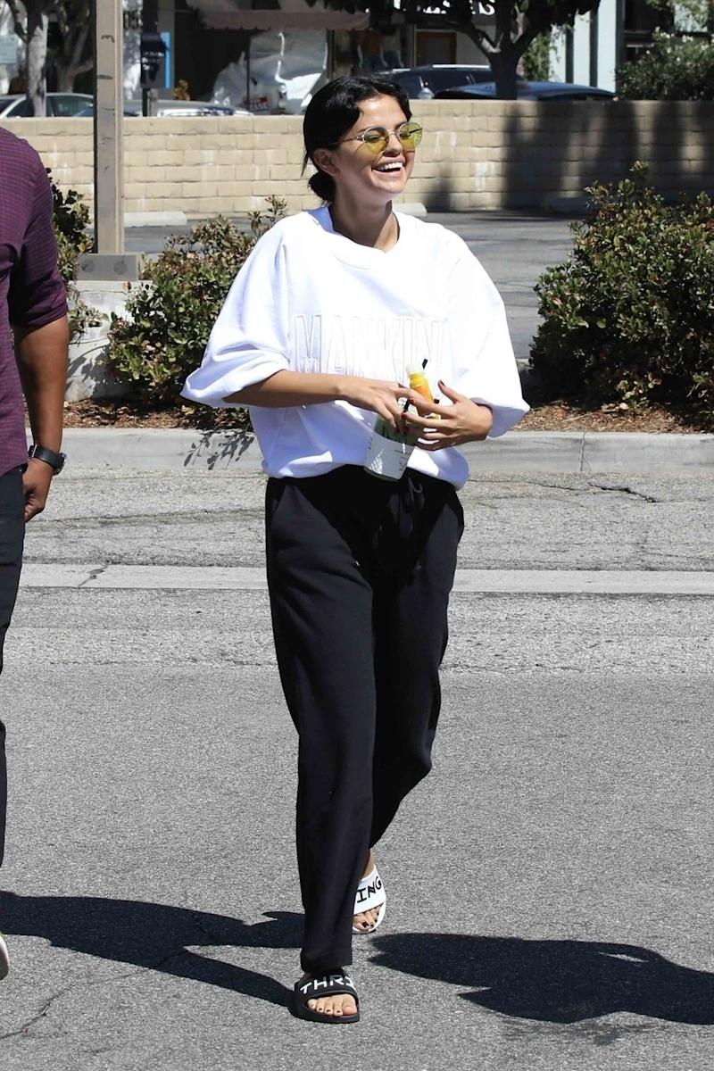 Studio City, CA - Selena Gomez looks carefree as she steps out for a coffee with her friends. Selena looks casual in sunglasses, a white sweater, black pants, and mismatched slides for the outing.Pictured: Selena GomezBACKGRID USA 22 SEPTEMBER 2018 BYLINE MUST READ: Vasquez-Max Lopes / BACKGRIDUSA: +1 310 798 9111 / usasales@backgrid.comUK: +44 208 344 2007 / uksales@backgrid.comUK Clients - Pictures Containing ChildrenPlease Pixelate Face Prior To Publication