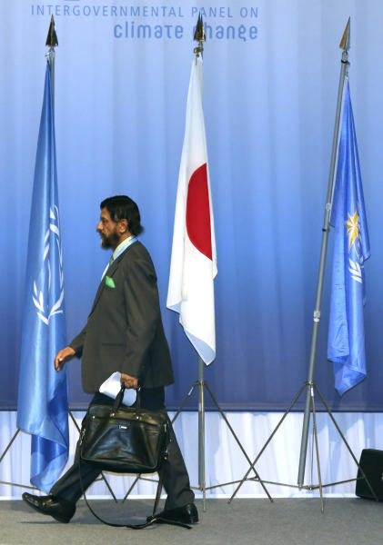 The chair of the Intergovernmental Panel on Climate Change (IPCC) Rajendra K. Pachauri walks in the venue during the opening session of the 10th Plenary of IPCC Working Group II and the 38th Session of the IPCC in Yokohama, Tuesday, March 25, 2014. The hundreds of scientists from 100 countries meeting in this Japanese port city are putting finishing touches on a massive report emphasizing the gravity of the threat the changing climate poses for communities from the polar regions to the tropics.(AP Photo/Eugene Hoshiko)