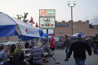 People dine outside at L&B Spumoni Gardens, Sunday, Oct. 4, 2020, in the Brooklyn borough of New York. The popular Brooklyn eatery is located in one of the Zip Codes that have seen a spike in coronavirus cases recently. New York's mayor said Sunday that he has asked the state for permission to close schools and reinstate restrictions on nonessential businesses in several neighborhoods, including that of Spumoni Gardens, because of a resurgence of the virus. (AP Photo/Kathy Willens)