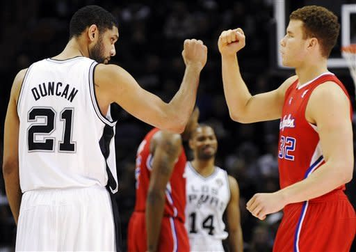 San Antonio Spurs' Tim Duncan, left, and Los Angeles Clippers' Blake Griffin greet one another before an NBA basketball game, Friday, March 9, 2012, in San Antonio. (AP Photo/Darren Abate)