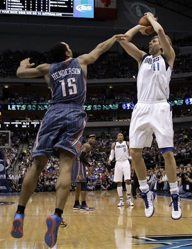 Dallas Mavericks' Dirk Nowitzki (41), of Germany, shoots over Charlotte Bobcats' Gerald Henderson (15) in the first half of an NBA basketball game on Thursday, March 15, 2012, in Dallas. (AP Photo/Tony Gutierrez)