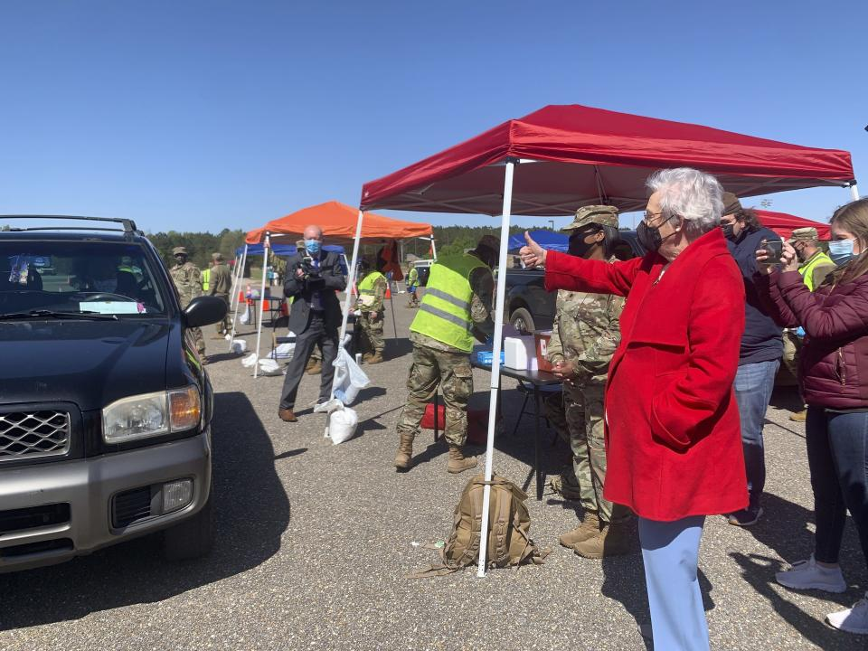 Alabama Gov. Kay Ivey gives a thumbs up to people in line to get COVID-19 vaccinations at an Alabama National Guard clinic in Camden, Ala., on Friday, April 2, 2021. (AP Photo/Kim Chandler)
