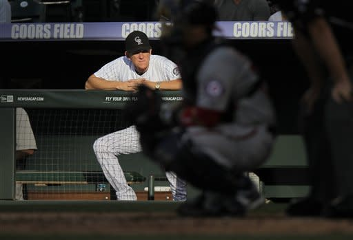 Colorado Rockies manager Jim Tracy watches from the dugout during the first inning of a baseball game against Washington Nationals, Wednesday, June 27, 2012, in Denver, Colo. (AP Photo/Barry Gutierrez)