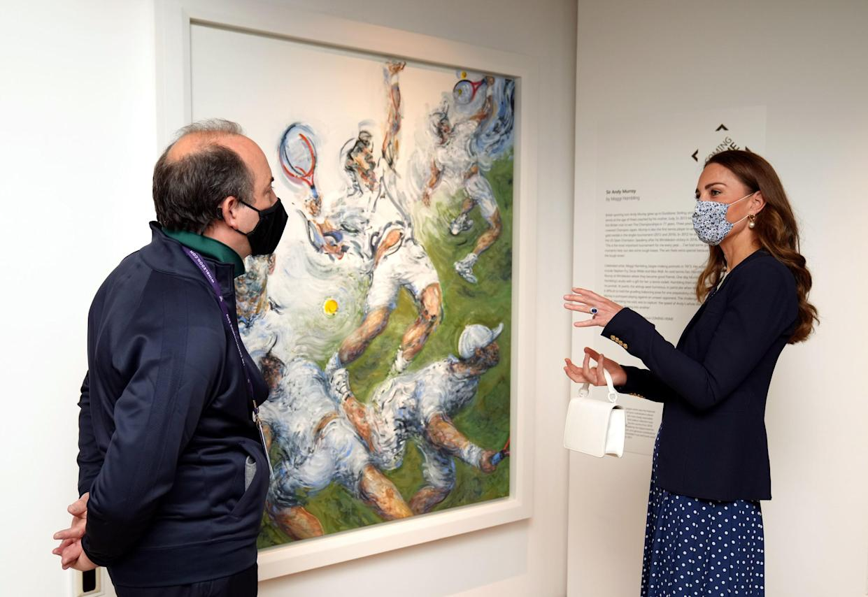 LONDON, ENGLAND - JULY 02: Catherine, Duchess of Cambridge views a portrait of Andy Murray by Maggi Hambling as she is shown around the Wimbledon Museum by the Head of Heritage at the All England Lawn Tennis Club Adam Chadwick during her official visit on day five of Wimbledon at The All England Lawn Tennis and Croquet Club, on July 2, 2021 in London, England. (Photo by John Walton - WPA Pool/Getty Images)