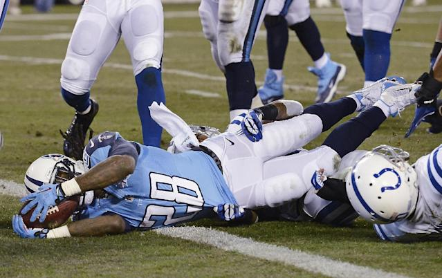 Tennessee Titans running back Chris Johnson (28) scores a touchdown on a 7-yard run against the Indianapolis Colts in the first quarter of an NFL football game Thursday, Nov. 14, 2013, in Nashville, Tenn. (AP Photo/Mark Zaleski)