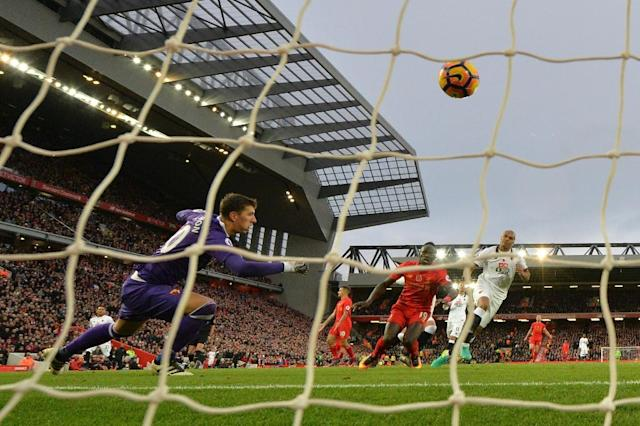Liverpool's Sadio Mane (2R) shoots past Watford's goalkeeper Costel Pantilimon to score his second, and the team's fifth goal at Anfield on November 6, 2016 (AFP Photo/Paul Ellis )