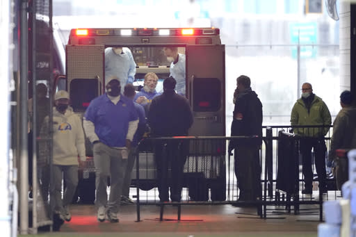 Los Angeles Rams quarterback John Wolford sits back after walking into an ambulance parked in a tunnel just off the field after being injured during the first half of an NFL wild-card playoff football game against the Seattle Seahawks, Saturday, Jan. 9, 2021, in Seattle. (AP Photo/Ted S. Warren)