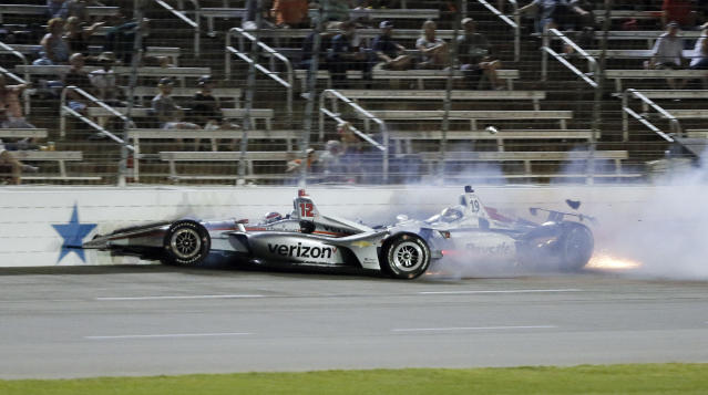 Will Power, left, of Australia, and Zachary Claman de Melo, of Canada, collide during the IndyCar auto race Saturday, June 9, 2018, in Fort Worth, Texas. (AP Photo/Brandon Wade)