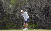 Defending champion Kevin Kisner hits a chip shot on the 12th green during a practice round for the Dell Technologies Match Play Championship golf tournament Monday, March 22, 2021, in Austin, Texas. (AP Photo/David J. Phillip)