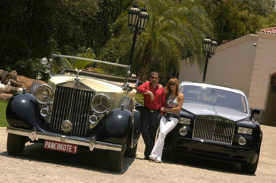 INDIA - MAY 10:  Yohan Poonawalla with his wife and two of his Rolls Royce cars. The favourite car of the maharajahs is making a comeback in India after half-a-century.  (Photo by Fawzan Husain/The The India Today Group via Getty Images)