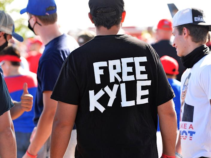 A man wears a shirt calling for freedom for Kyle Rittenhouse, 17, the man who allegedly shot protesters in Wisconsin, during a US President Donald Trump Campaign Rally, the day after the end of the Republican National Convention, at Manchester airport in Londonderry, New Hampshire, on August 28.