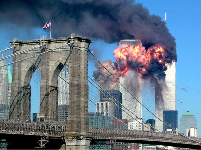 The second tower of the World Trade Center bursts into flames after being hit by a hijacked airplane on Sept. 11, 2001. (Sara K. Schwittek/Reuters)