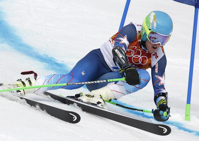 United States' Ted Ligety passes a gate in the first run of the men's giant slalom at the Sochi 2014 Winter Olympics, Wednesday, Feb. 19, 2014, in Krasnaya Polyana, Russia. (AP Photo/Charles Krupa)