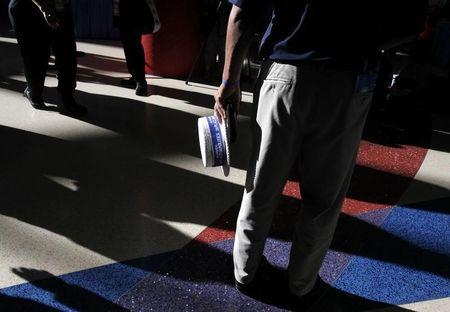 Delegates cast long shadows on the concourse during the Democratic National Convention in Charlotte