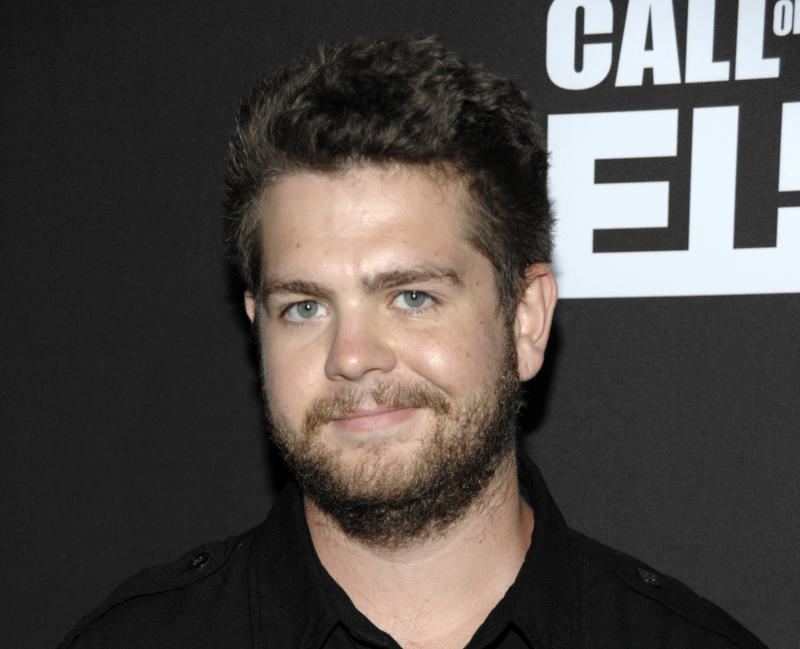 "FILE - This Sept. 3, 2011 file photo shows Jack Osbourne at the ""Call of Duty: Modern Warfare 3"" video game launch party in Los Angeles. Jack Osbourne is facing a diagnosis of multiple sclerosis. The former reality star and son of Ozzy and Sharon Osbourne revealed his health crisis in an interview with People released Sunday, June 17, 2012. He told the magazine he was angry and frustrated when he found out, and he's concerned about his family. (AP Photo/Dan Steinberg, file)"