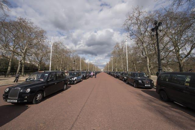 London black cabs line The Mall near Buckingham Palace