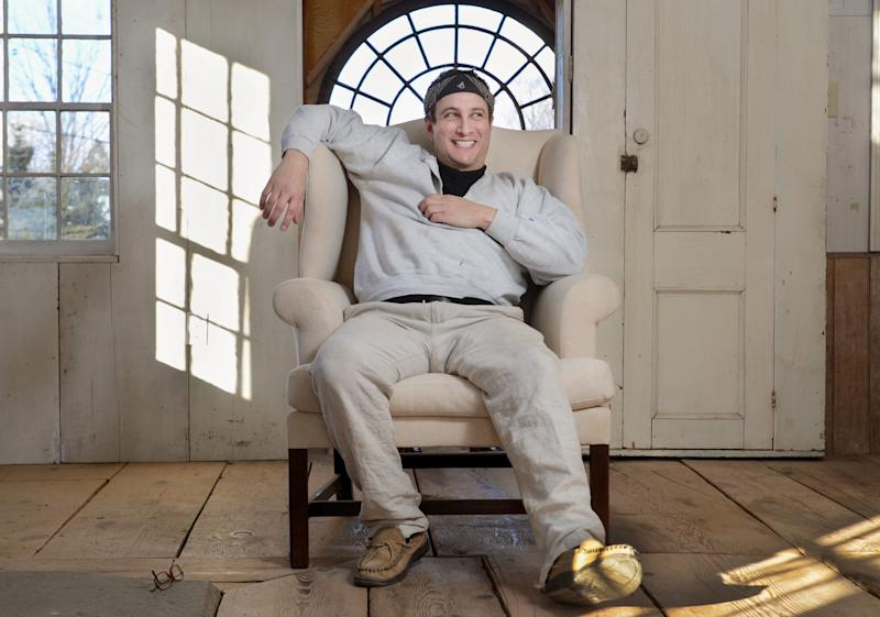 """In this photo taken Feb. 1, 2012, Bronson Pinchot poses for photos at his home in Harford, Pa. Pinchot, best known for his starring role on the 1980's sitcom """"Perfect Strangers,"""" is back on TV with a new show about restoring his historic Pennsylvania homes. The show, """"The Bronson Pinchot Project,"""" premiered this month on the DIY cable network. (AP Photo/Heather Ainsworth)"""