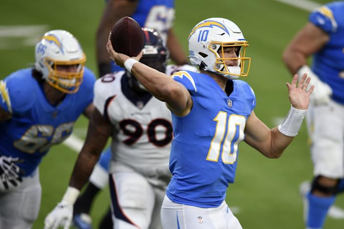 Chargers quarterback Justin Herbert delivers a pass against the Denver Broncos.