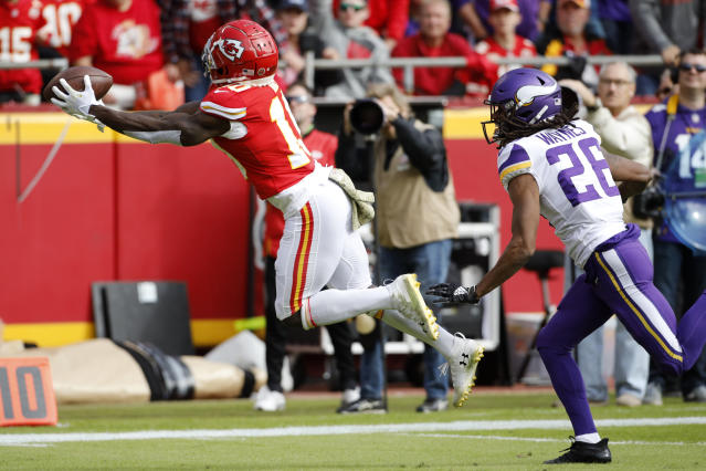 Kansas City Chiefs wide receiver Tyreek Hill (10) catches a 40-yard touchdown pass in front of Minnesota Vikings cornerback Trae Waynes (26) during the first half of an NFL football game in Kansas City, Mo., Sunday, Nov. 3, 2019. (AP Photo/Colin E. Braley)