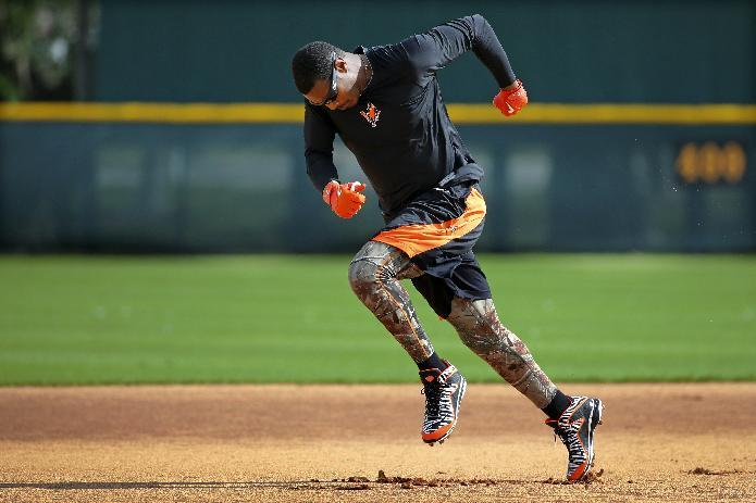 Baltimore Orioles' Adam Jones runs the bases after taking batting practice at the team's spring training baseball facility in Sarasota, Fla., Thursday, Feb. 13, 2014. Orioles pitchers and catchers are scheduled for their first workout on Friday, with the first full squad workout Feb. 19. (AP Photo/Gene J. Puskar)