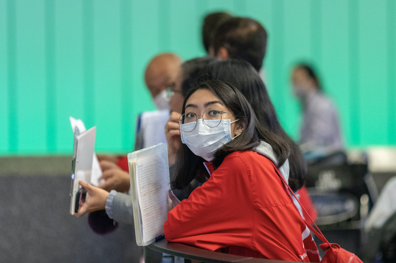 A woman waiting for an international traveler to arrive to LAX Tom Bradley International Terminal wears a medical mask for protection against the coronavirus outbreak on February 2, 2020 in Los Angeles, California. (Photo: David McNew/Getty Images)
