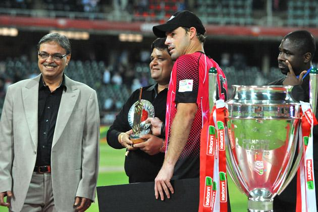 Michael Lumb (2nd R) of the Sixers receives his awards for Man of the Match and the Golden Bat during the Karbonn Smart CLT20 Final match between bizhub Highveld Lions and Sydney Sixers at Bidvest Wanderers Stadium on October 28, 2012 in Johannesburg, South Africa. (Photo by Duif du Toit/Gallo Images/Getty Images)