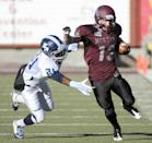 San Diego cornerback Toney Sawyer (21) reaches to tackle Montana wide receiver Josh Janssen (13) during the first half of an NCAA college football playoff game, Saturday, Nov. 29, 2014, in Missoula, Mont. (AP Photo/Lido Vizzutti)