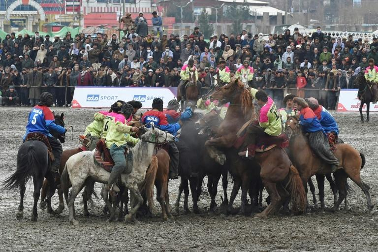 Horsemen compete during Afghanistan's first buzkashi league, in Kabul on March 12 (AFP Photo/WAKIL KOHSAR)