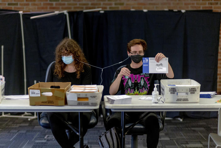 Melissa Thompson, 19, and Kyle Thompson, 20, prepare absentee ballots for mailing in West Bloomfield Township, Mich., Sept. 24, 2020. (Sylvia Jarrus/The New York Times)