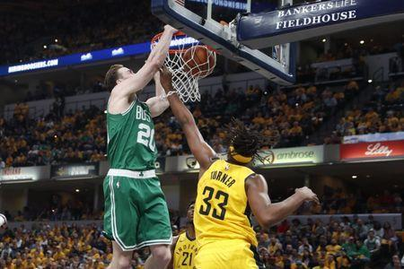 Apr 21, 2019; Indianapolis, IN, USA; Boston Celtics forward Gordon Hayward (20) dunks the ball past Indiana Pacers center Myles Turner (33) during the third quarter of game four of the first round of the 2019 NBA Playoffs at Bankers Life Fieldhouse. Mandatory Credit: Brian Spurlock-USA TODAY Sports