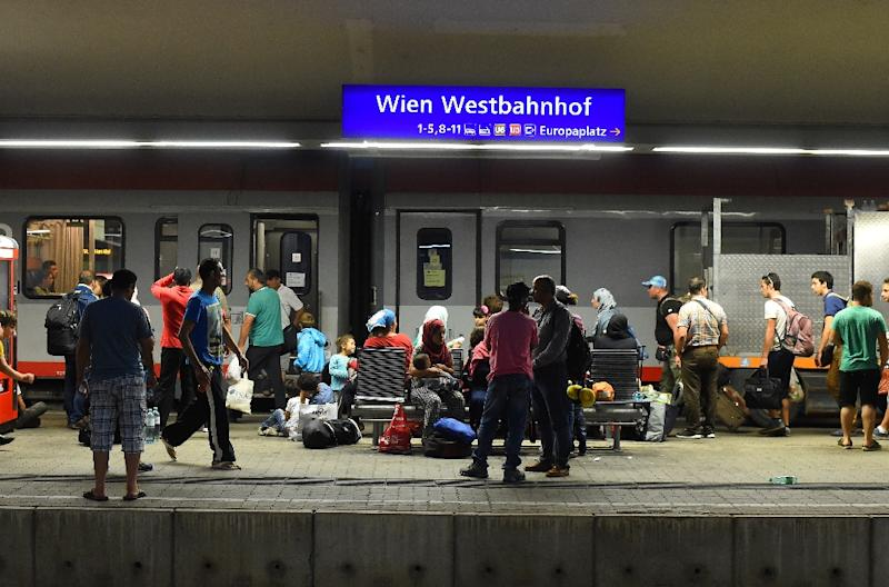 Migrants rest on a platform at Vienna's Westbahnhof railway station in the early hours of September 1, 2015. (AFP Photo/Joe Klamar)