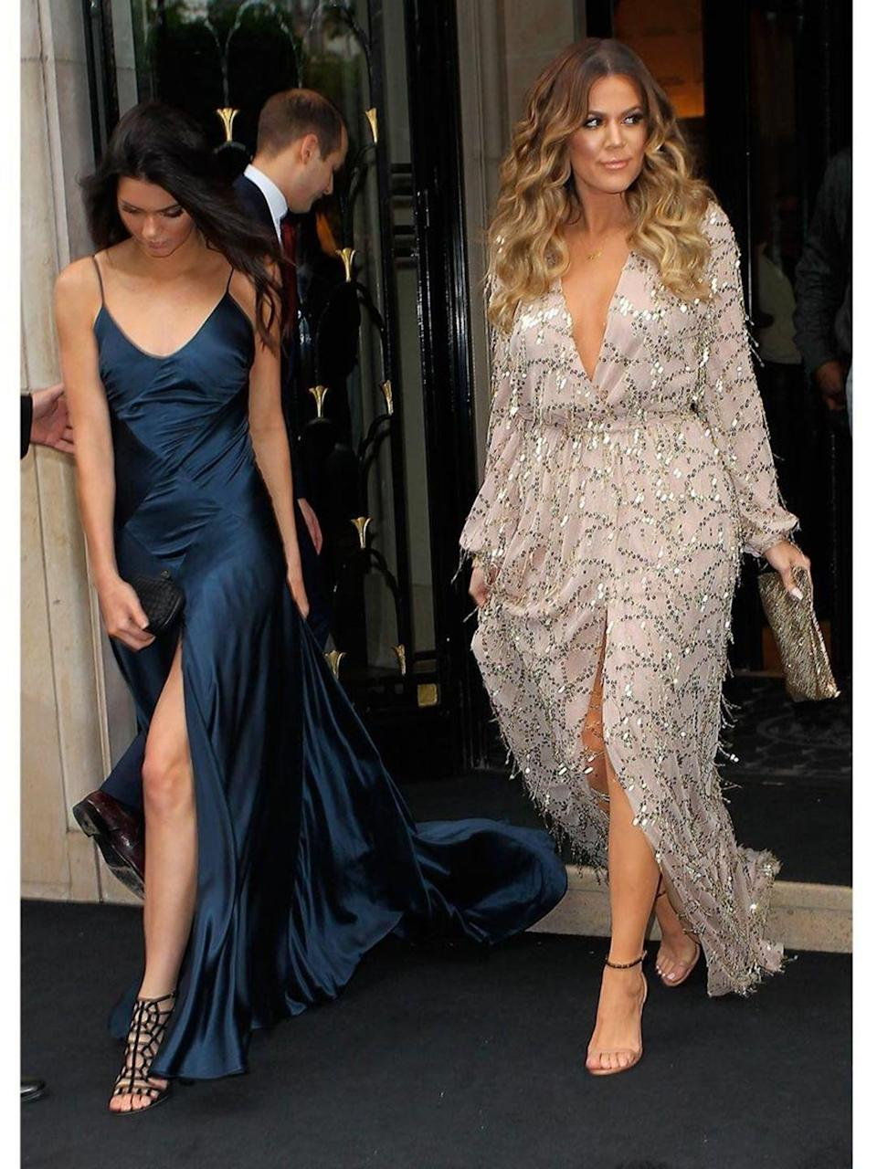 """<p>With Khloe Kardashian, leaving the Four Seasons George V Hotel, Paris.</p><p><a href=""""http://www.elleuk.com/style/occasions/kim-kardashian-kanye-west-wedding-paris-pictures"""" rel=""""nofollow noopener"""" target=""""_blank"""" data-ylk=""""slk:See every pic from the Kimye wedding weekend"""" class=""""link rapid-noclick-resp"""">See every pic from the Kimye wedding weekend</a></p>"""