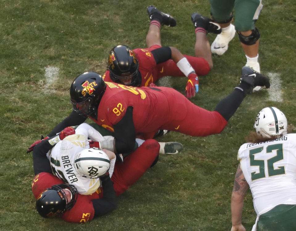 Iowa State defensive lineman Jamahl Johnson, top, and Iowa State linebacker Mike Rose, bottom, sack Baylor quarterback Charlie Brewer, center, during the first half of an NCAA college football game, Saturday, Nov. 10, 2018, in Ames. (AP Photo)