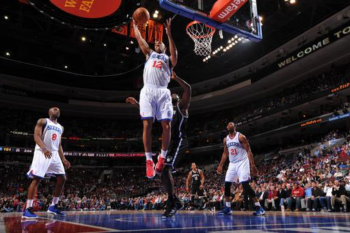 PHILADELPHIA, PA - MARCH 11: Evan Turner #12 of the Philadelphia 76ers grabs a rebound against the Brooklyn Nets at the Wells Fargo Center on March 11, 2013 in Philadelphia, Pennsylvania. (Photo by Jesse D. Garrabrant/NBAE via Getty Images)