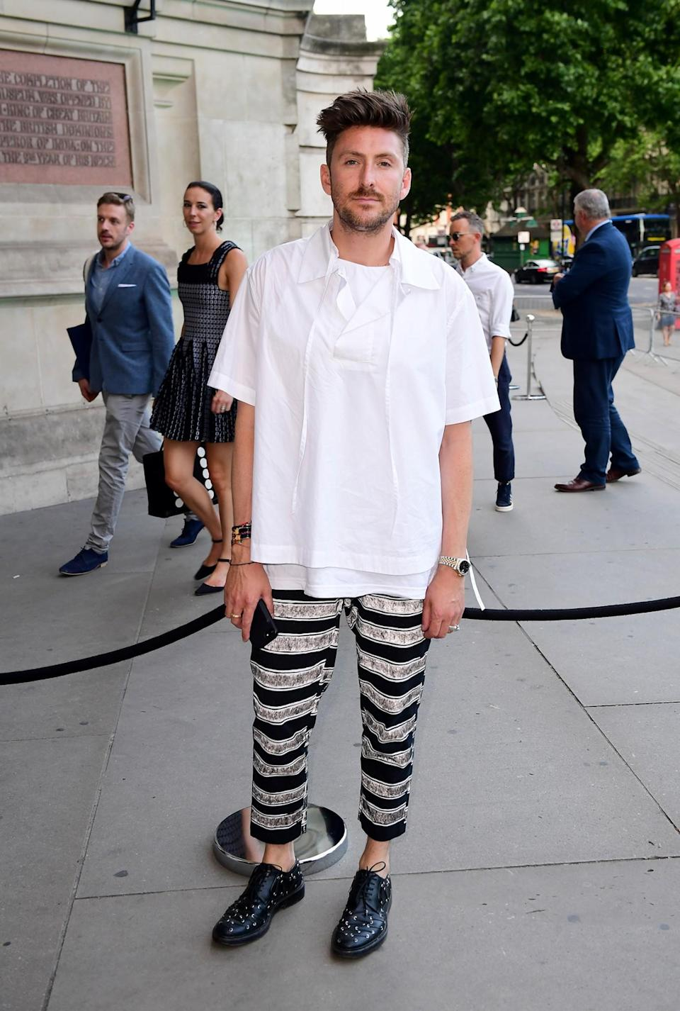 <p>The London Fashion Week designer kept cool in a baggy shirt and striped trousers – but probably wasn't quite dressy enough for the royal-studded event.<br><em>[Photo: PA]</em> </p>