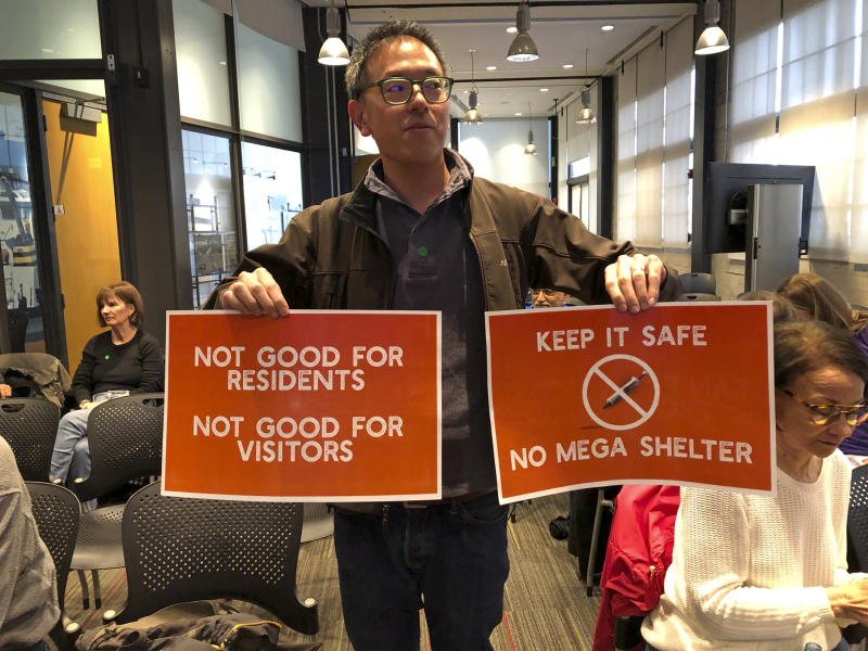 In this photo taken Monday, April 15, 2019, resident Wallace Lee helps lead the fight against a new homeless shelter during a neighborhood meeting in San Francisco. The city of San Francisco, which has too little housing and too many homeless people sleeping in the streets, is teeming with anxiety and vitriol these days. A large new homeless shelter is on track to go up along a scenic waterfront area dotted with high-rise luxury condos, prompting outrage from some residents. (AP Photo/Janie Har)