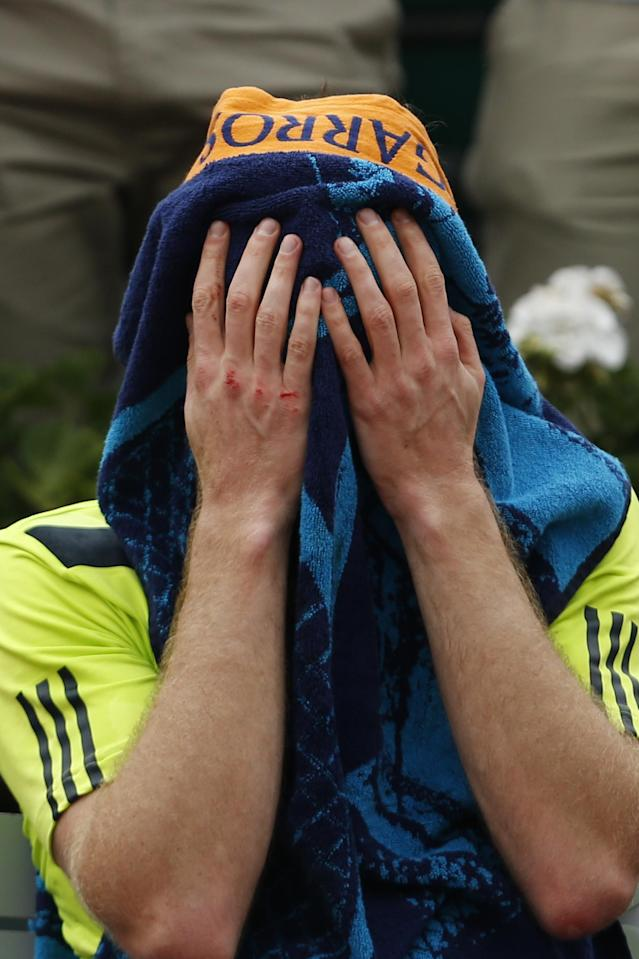 Britain's Andy Murray towels off after winning the third round match of the French Open tennis tournament against Germany's Philipp Kohlschreiber at the Roland Garros stadium, in Paris, France, Sunday, June 1, 2014. Murray won in five sets 3-6, 6-3, 6-3, 4-6, 12-10. (AP Photo/Darko Vojinovic)
